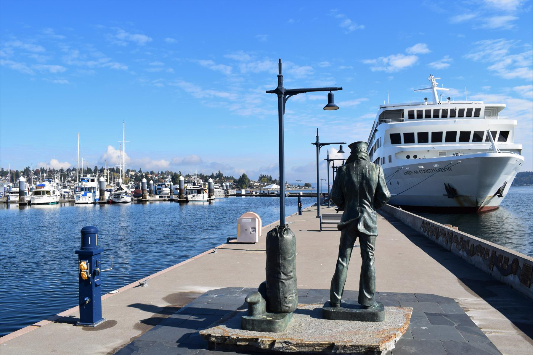 Lone Sailor Statue and Cruise Ship